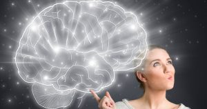Woman pointing to a brain illustration
