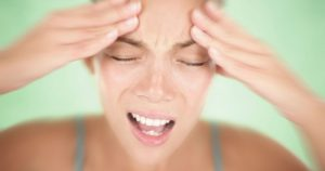 Woman is experiencing a headache