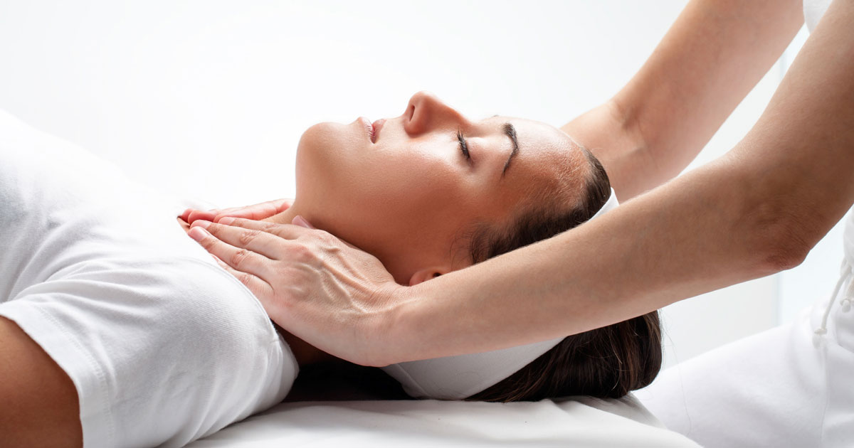 A woman is receiving chiropractic treatment