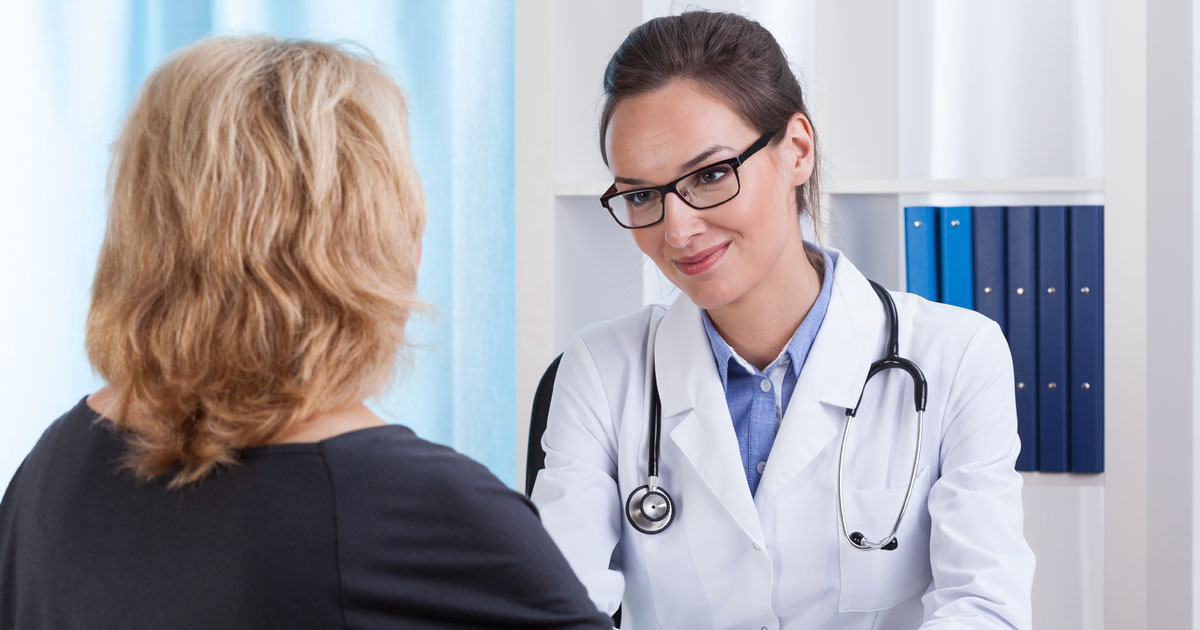 Doctor listening to patient's concerns