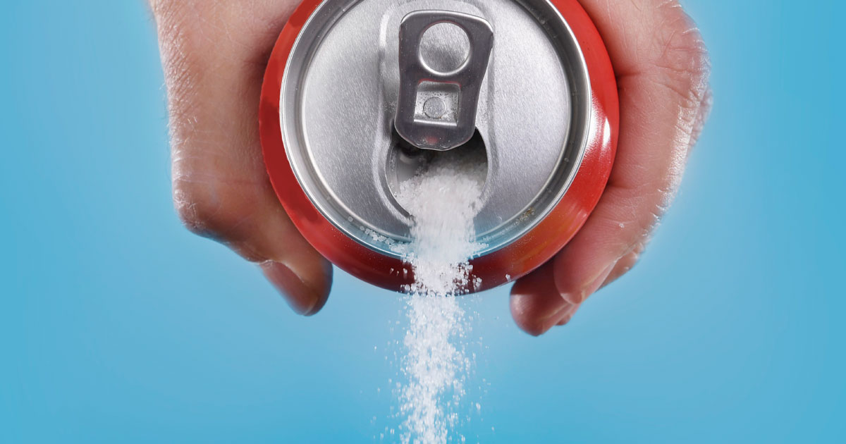 Pouring sugar out of a pop can