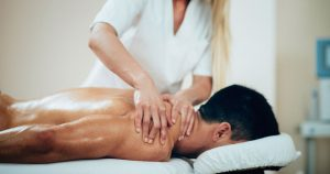 Man is receiving a back massage