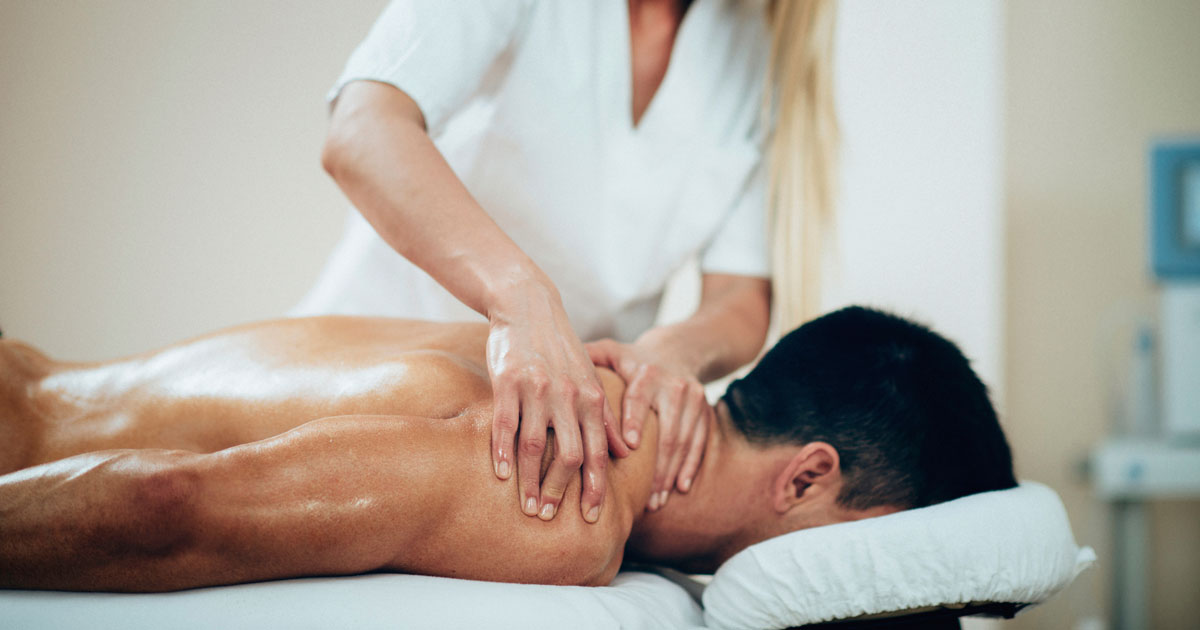 Man is receiving a back massage