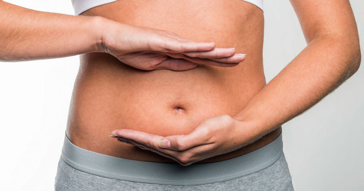 Woman touching her stomach
