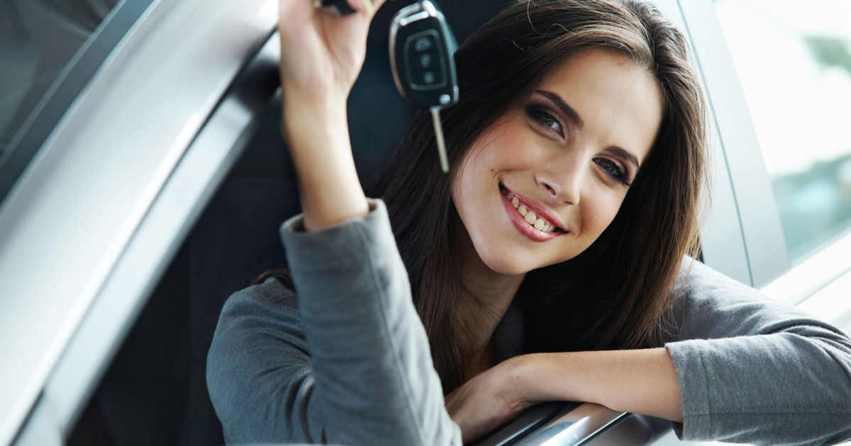 Woman in car holding car keys