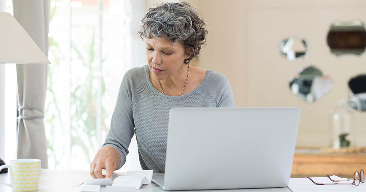 Woman on her computer looking at notes