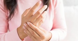 Woman experiencing numbness in her hands