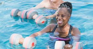 Woman and friend doing water aerobics