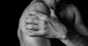 Hand gripping arm