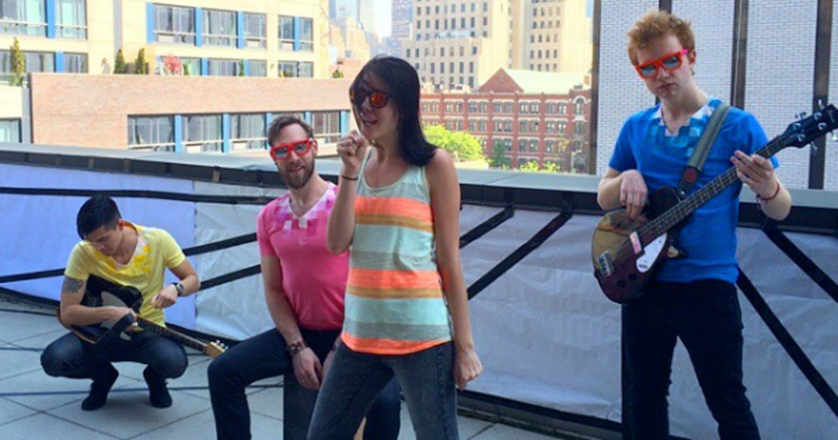 Four band members on a rooftop