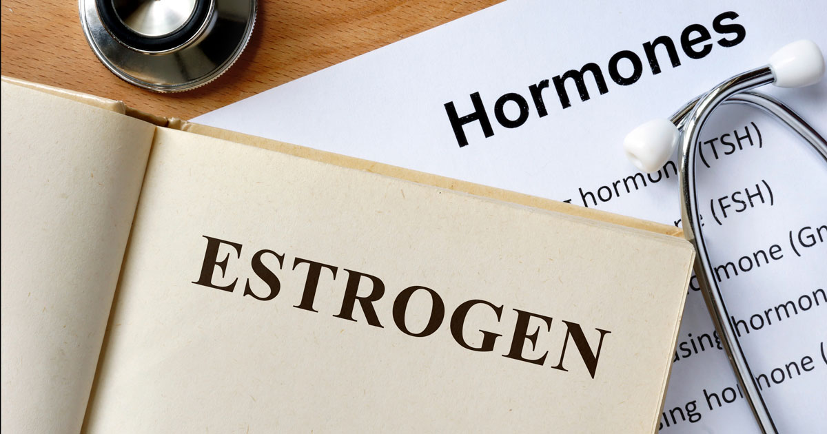 "Books and papers reading ""estrogen"" and ""hormones"" with stethoscope"