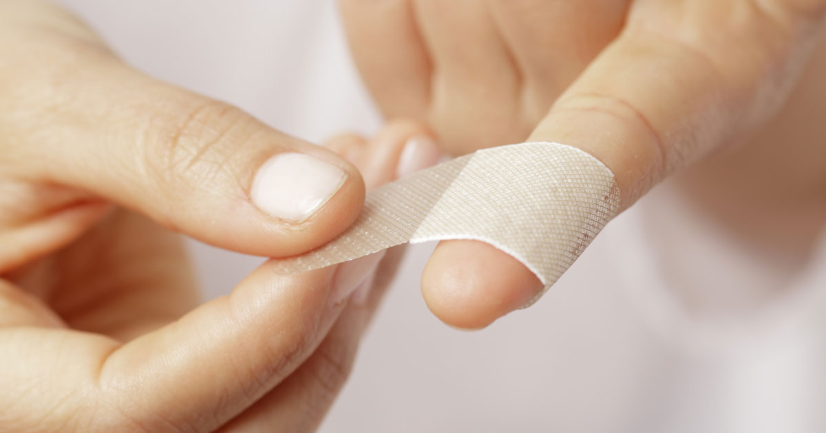 Putting tape on finger