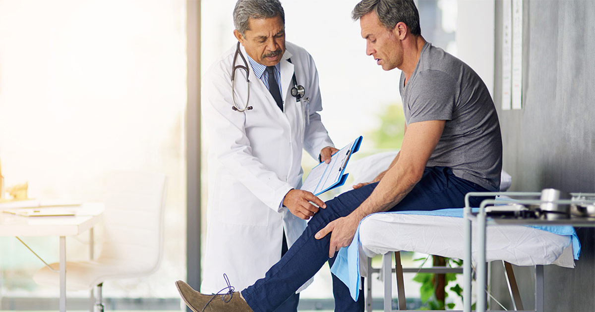 Man having his leg checked out by a doctor