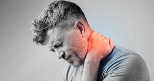 Man experiencing neck pain